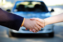 shaking hands with car