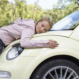 image of girl hugging new used car