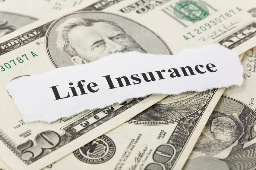 life insurance sign on top of money pile